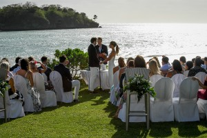 The couple exchange vows besides the Pacific Ocean