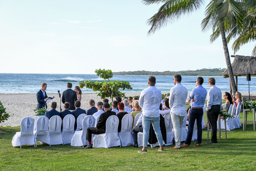 The guests watch the ceremony taking place at the shores of the Intercontinental Fiji