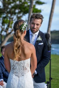 Groom smiles at vows