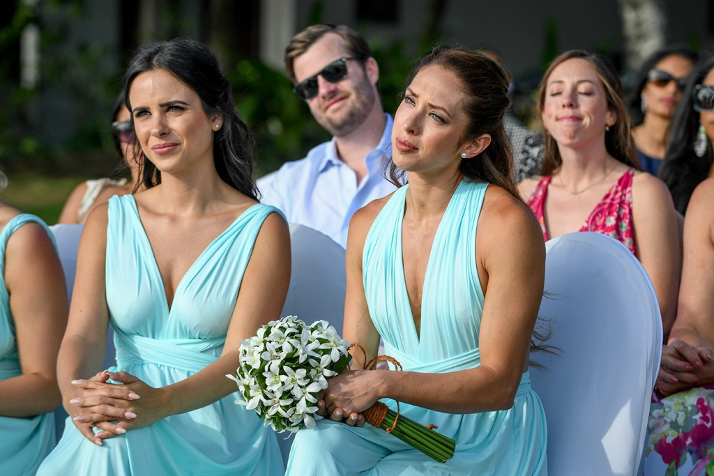 Bridesmaids watch in tears as they exchange vows