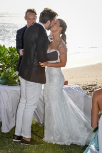The couple shares a passionate kiss as newly-weds