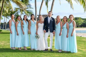 The newly weds pose with the bridesmaids