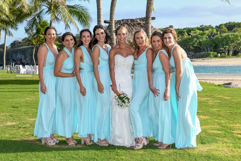 The bride poses with her bridesmaids
