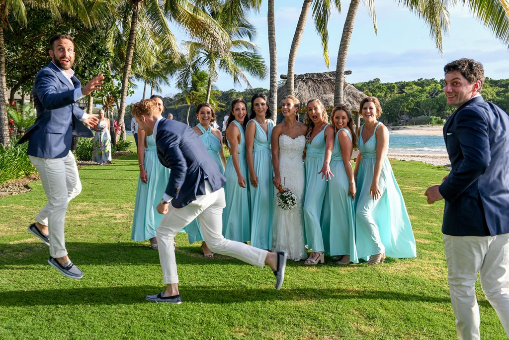 The groomsmen photobomb the bridesmaids pictures
