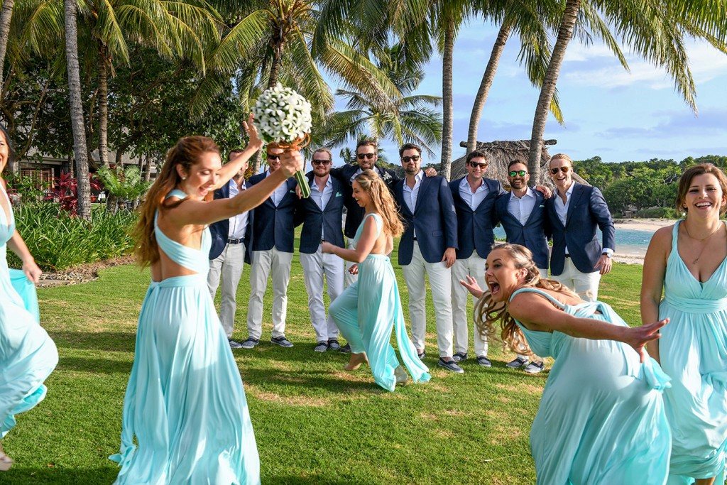 The bridesmaids photobomb the groomsmen's picture