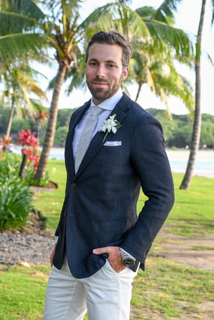The dapper groom poses in his custom suit from Suit supply