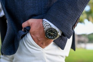 A closeup of the groom's Omega watch