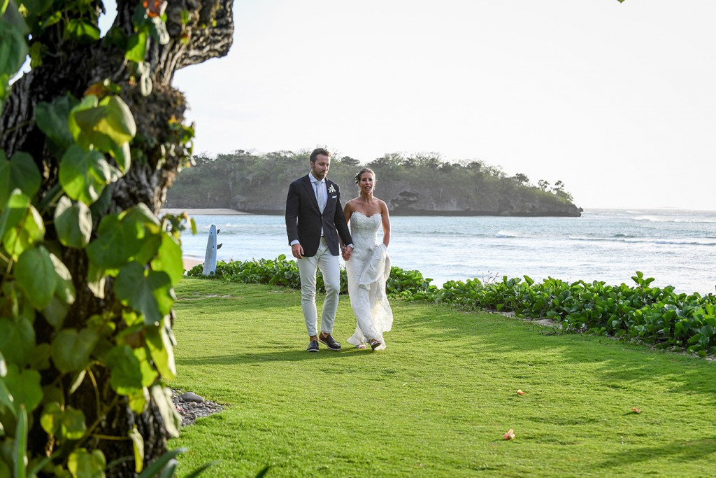 The newly weds stroll alongside the Pacific Ocean