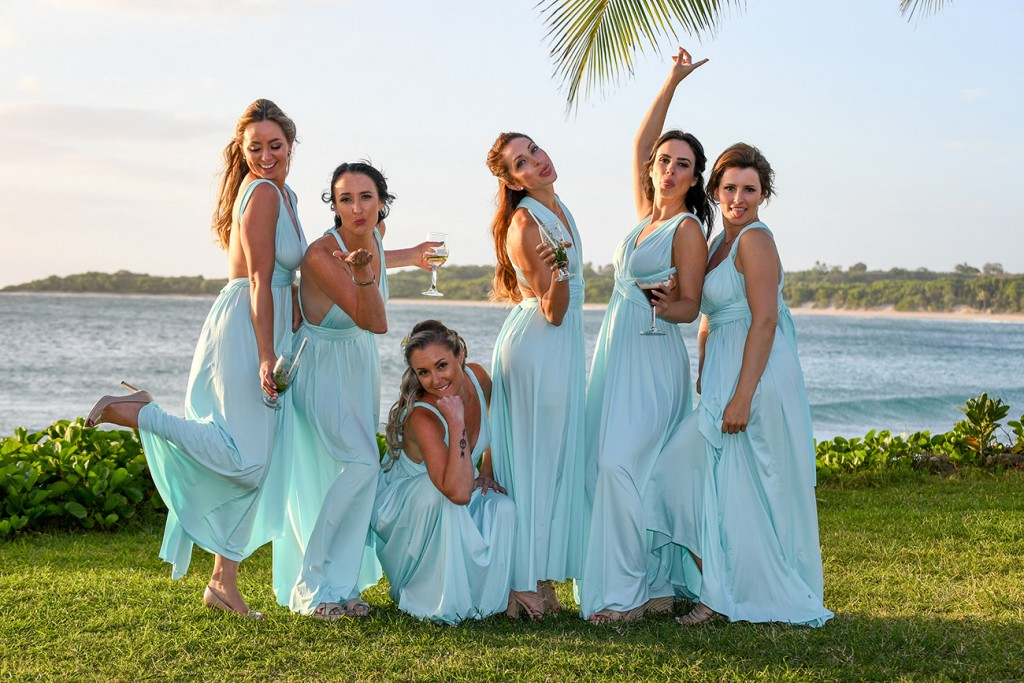 The bridesmaids pose for a cute pic by the beach