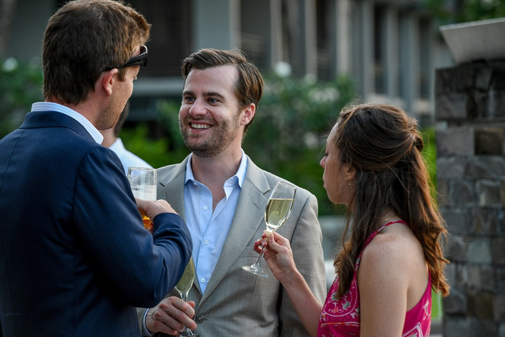 Wedding guests chat over a drink