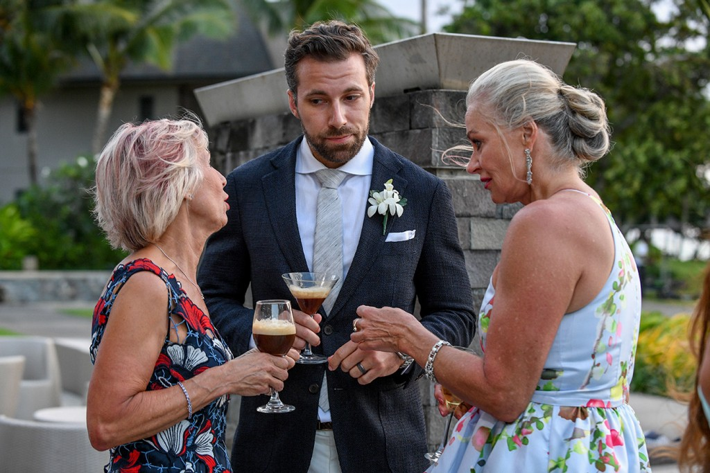 The groom chats with his two mothers