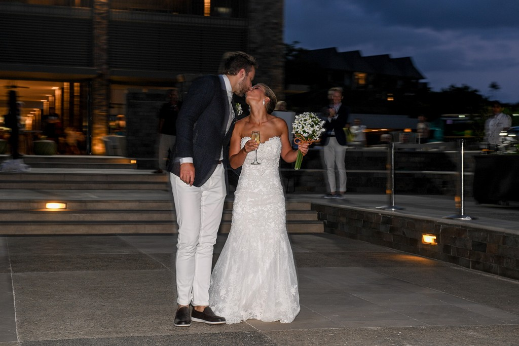 The newly-weds kiss at the Intercontinental Fiji