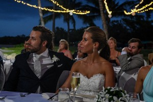 The newly weds listen to speeches at the wedding reception