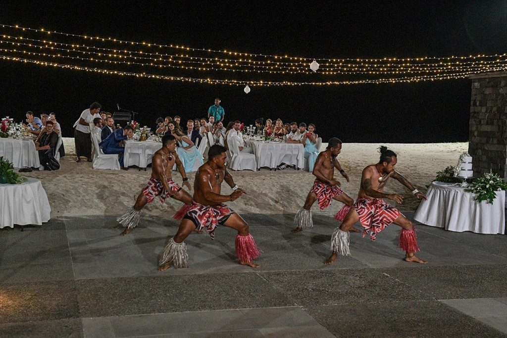 The traditional dancers dance under fairy lights as guests watch