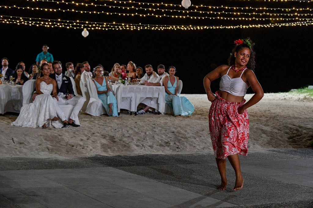 Guests watch a traditional Fiji dancer under fairy lights