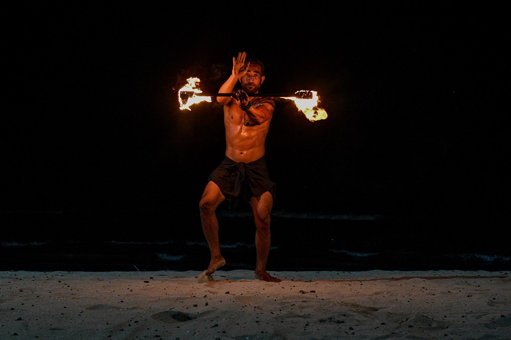 A fire dance is performed by a Rue Fiji dancer