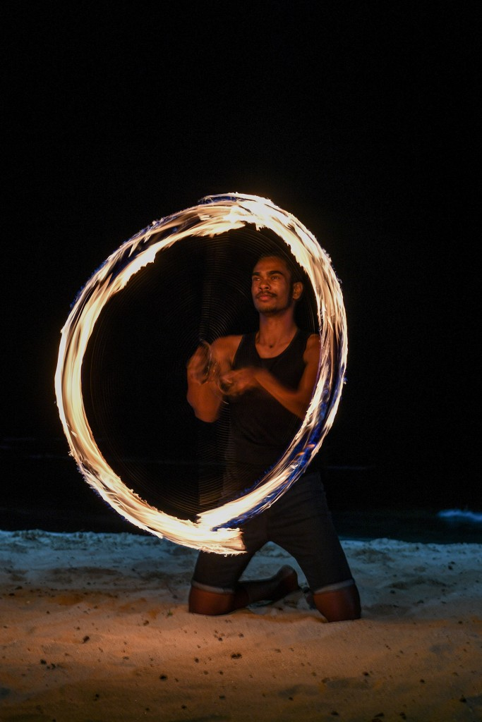A traditional Fiji dancer from Rue Fiji performs a fire dance