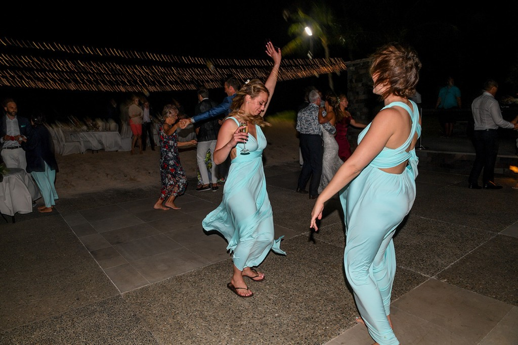 The bridesmaids dance wildly at the reception
