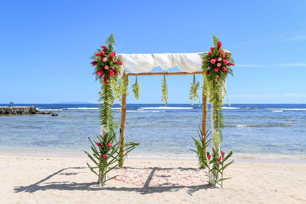 The simple bamboo altar adorned with fresh tropical flowers