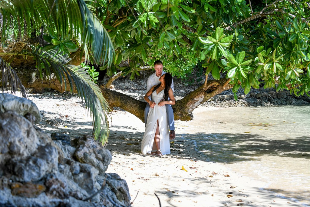 The newly-weds cuddle under a gigantic tree at Savasi