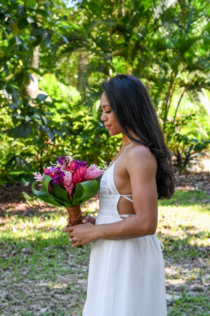 The stunning bride poses with her fresh, tropical Fiji flower bouquet