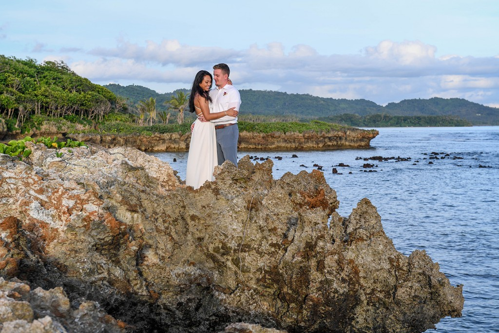 The newly-weds pose on a coral rock at Savasi Fiji