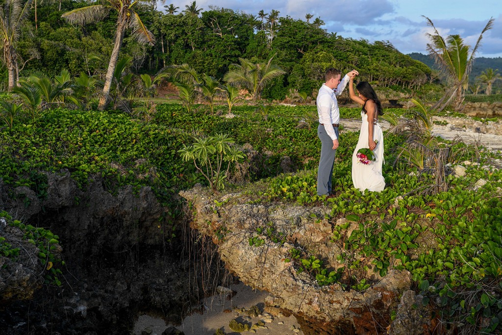 The couple dances atop a bed of green weeds