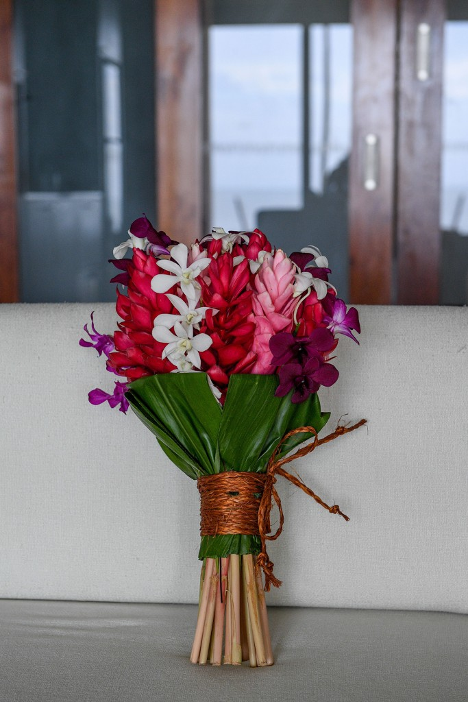 A stunning bouquet with a mix of white frangipani and red gingers
