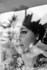 A stunning monochrome photo of the bride staring out of the window