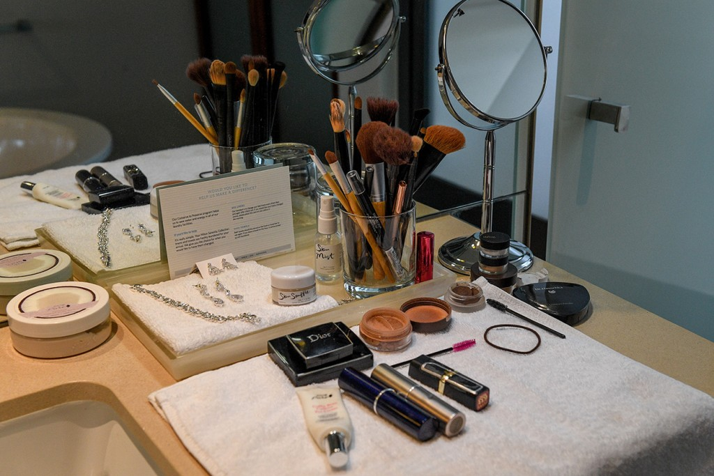 The bride's makeup spread in front of the dressing table
