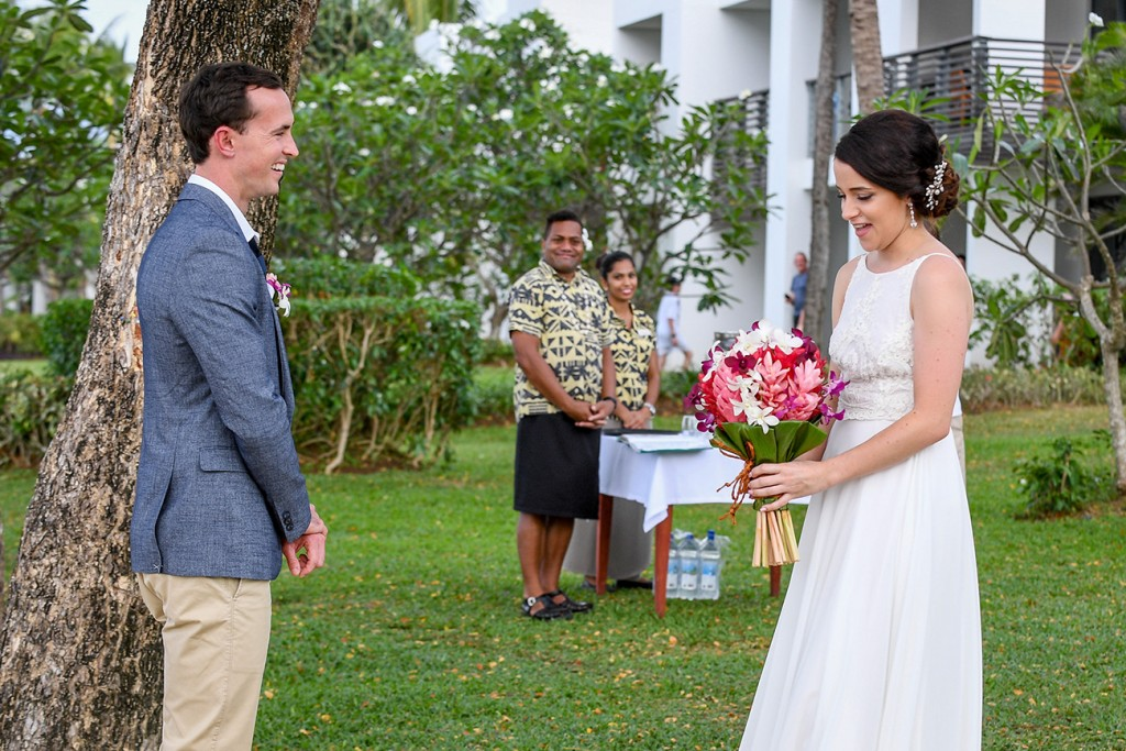 The couple share a laugh at the altar