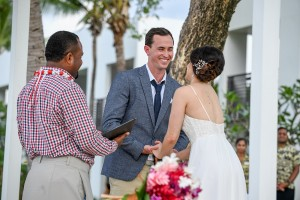The groom has a light moment while sharing his vows