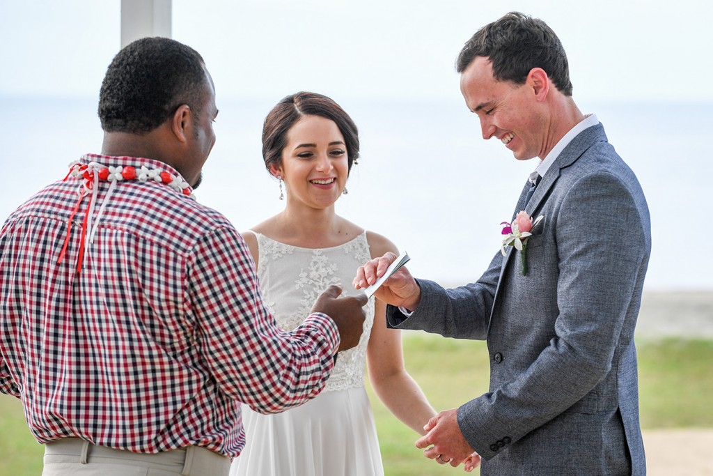 The celebrant hands over the marriage certificate to the groom