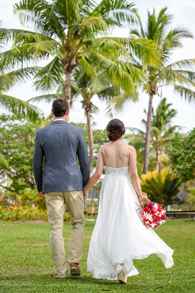 The newly married couple walk away together as man and wife.
