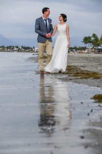 The sea reflects the newly weds strolling on the beach at Denarau Fiji