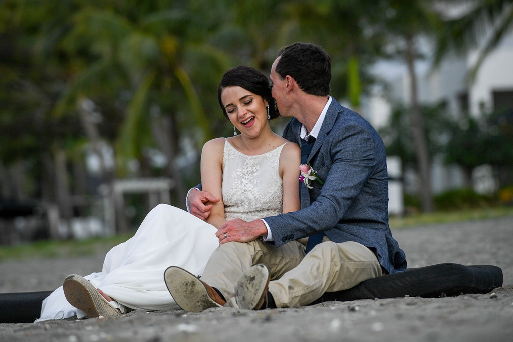 The newly-weds cuddle on the shores of the Pacific Ocean at Denarau Fiji