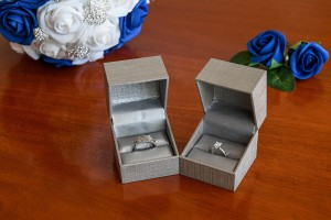Sparkling silver and diamond rings in metallic grey ring boxes