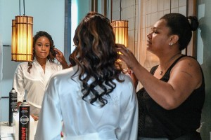 The bride reviews her hair and makeup through her reflection