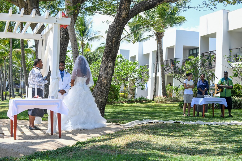 A wideshot of the married couple exchanging their vows at Hilton Fiji