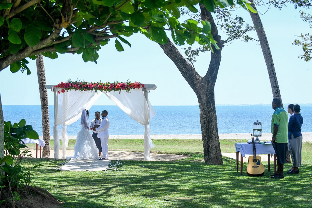 The couple exchanges their vows while overlooking the stunning sea at Fiji