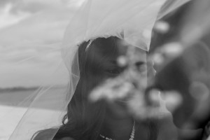 A stunning bokeh photo of the bride under the veil