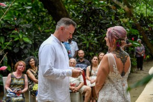 The groom reads his vows to his bride