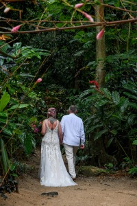 Newly wed stroll in forest