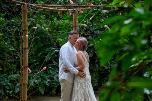 The newly weds have an intimate moment in the tropical rain forest