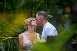 The newly weds share a passionate kiss in the heart of the forest