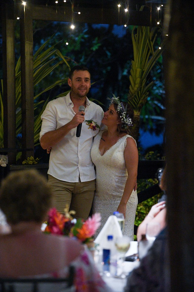 The groom makes a speech with his stunning bride by his side