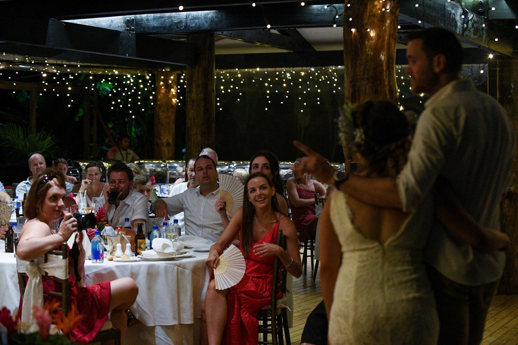 The wedding guests watch keenly as the newly weds make a speech