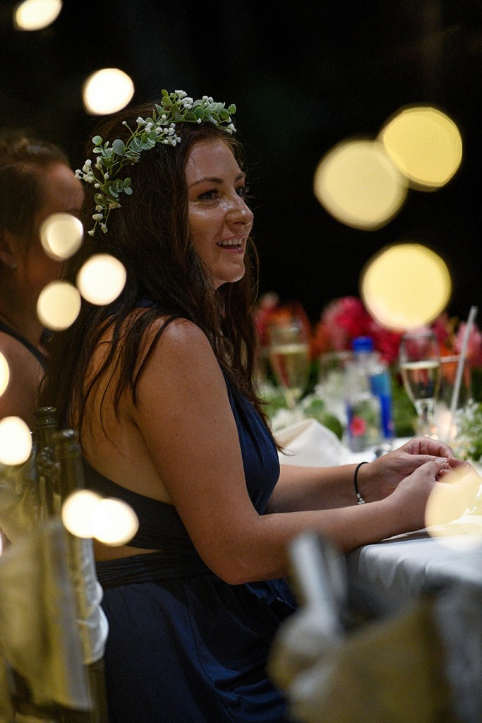 A wedding guest watches the ceremony with joy