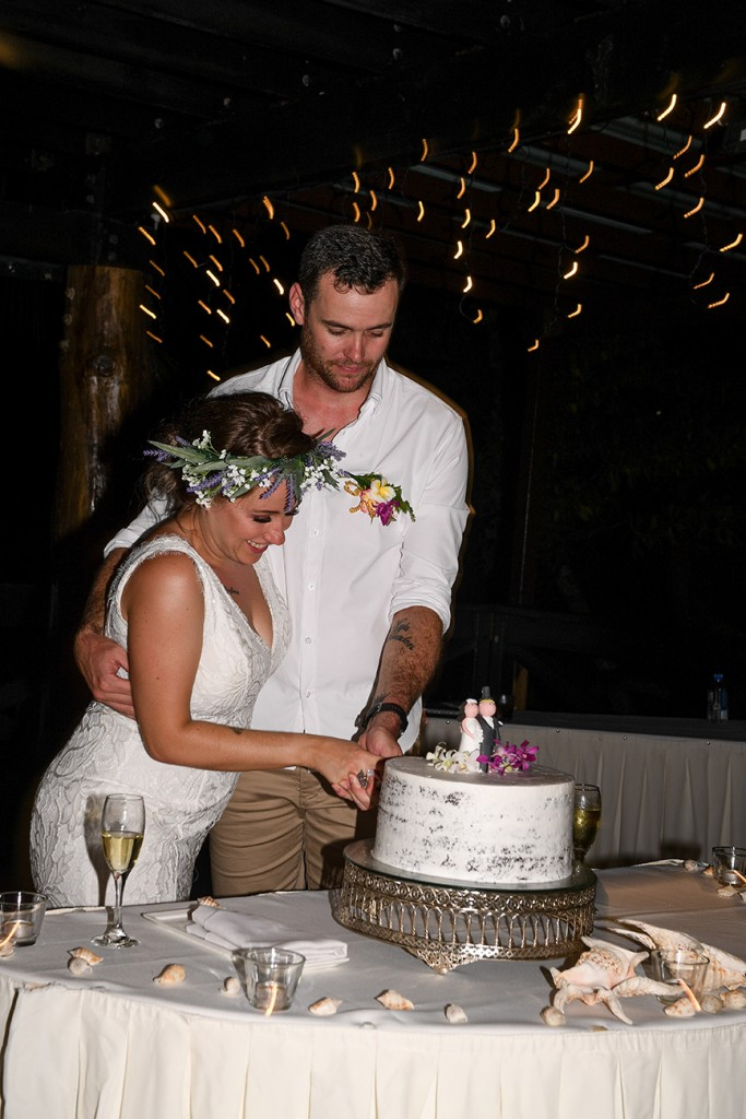 The bride and groom cut their wedding cake at their reception