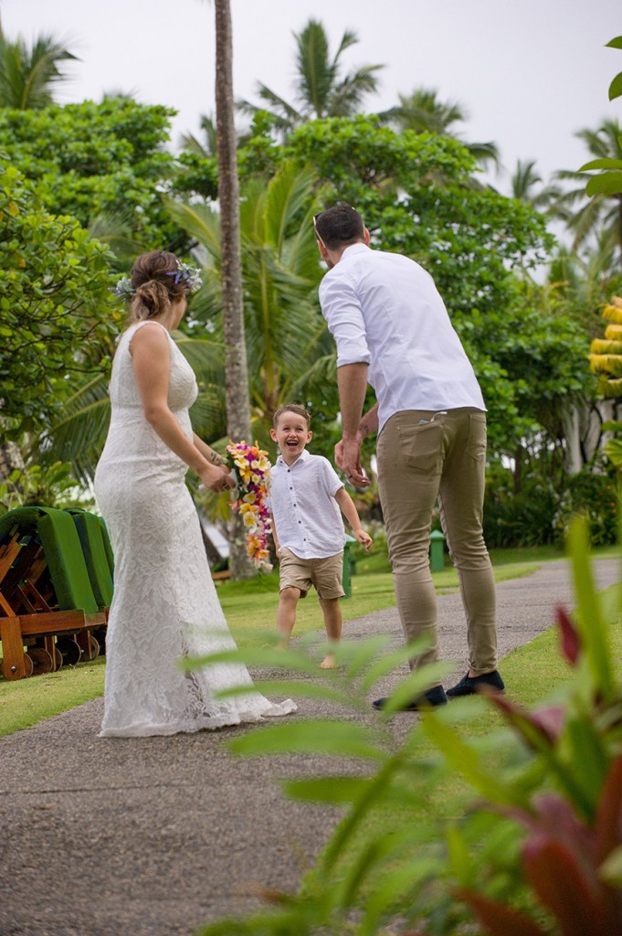 The bride and groom wait to hug their son at the Warwick Fiji